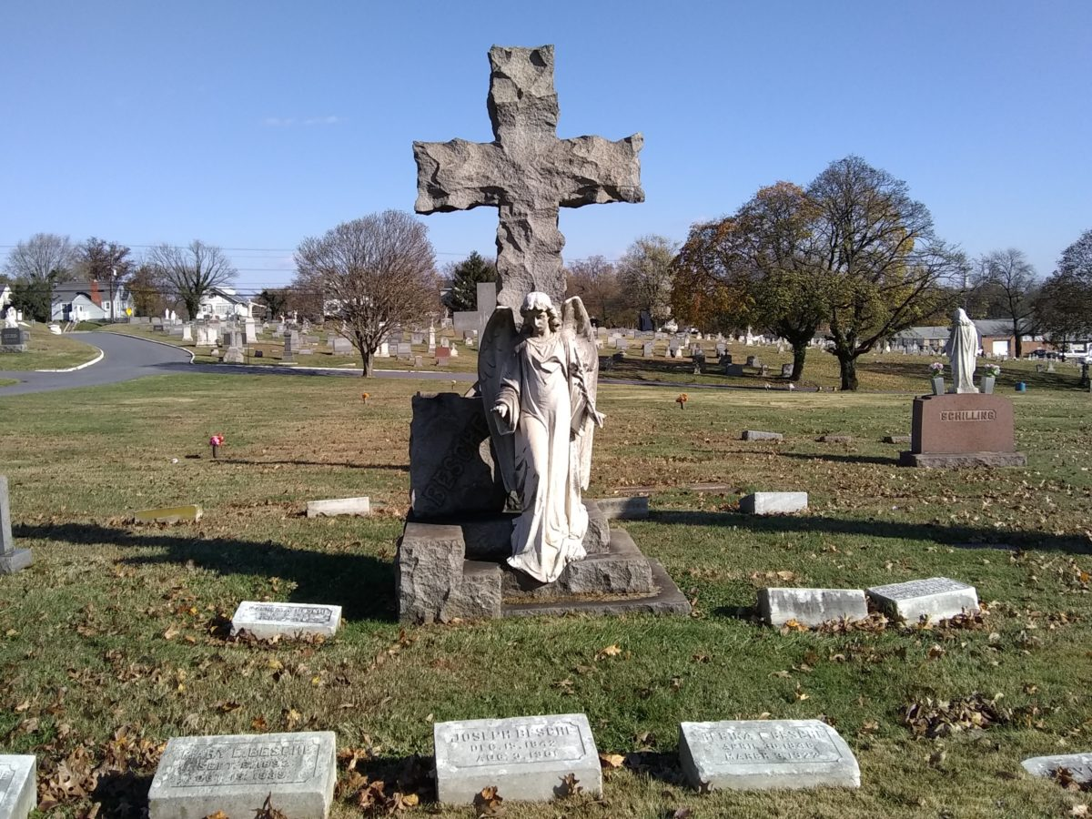 Gravesite at Holy Cross with an impressive angel monument