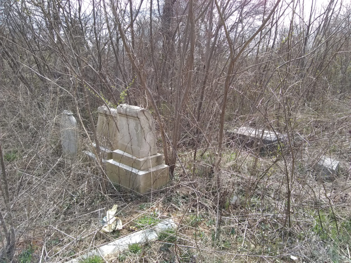 Overgrown headstones