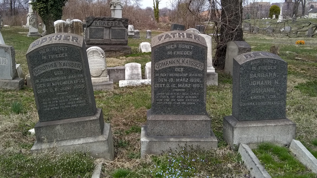 Three headstones, carved in German