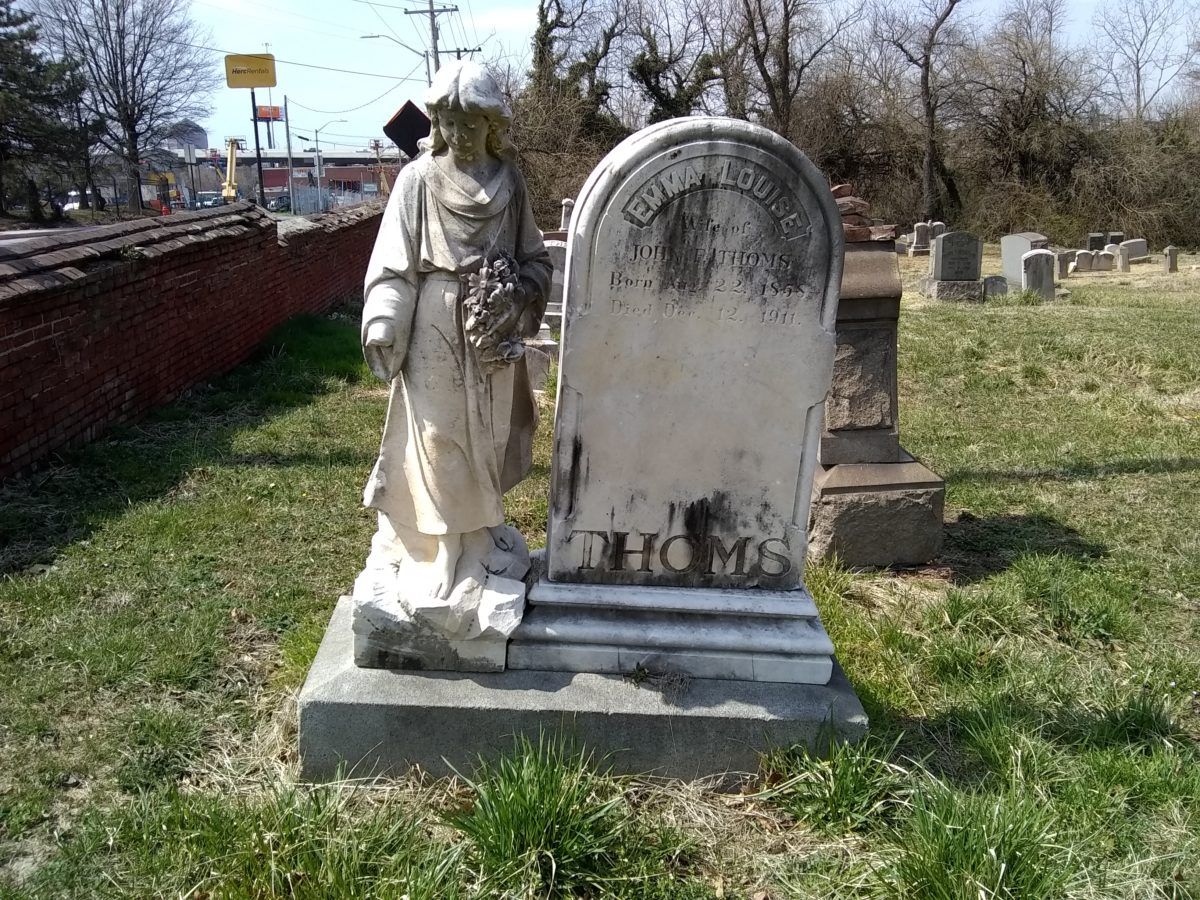A headstone and a statue