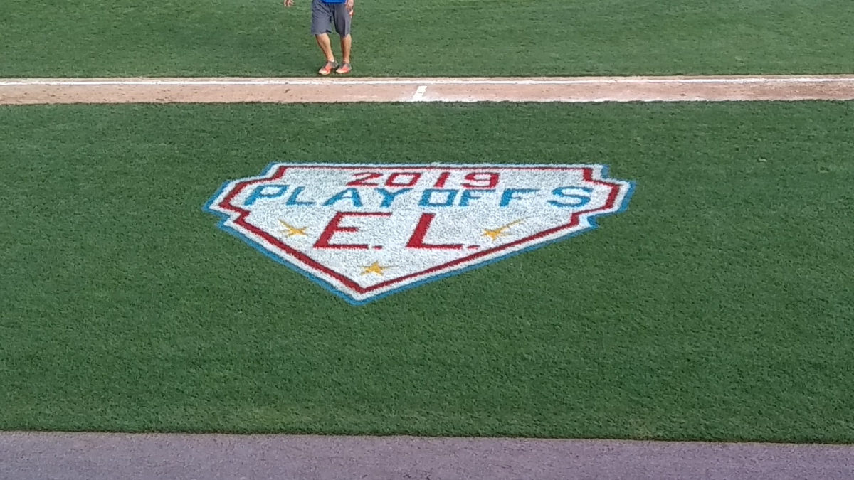 Decoration painted on the field on the first base side, which looks like a home plate.