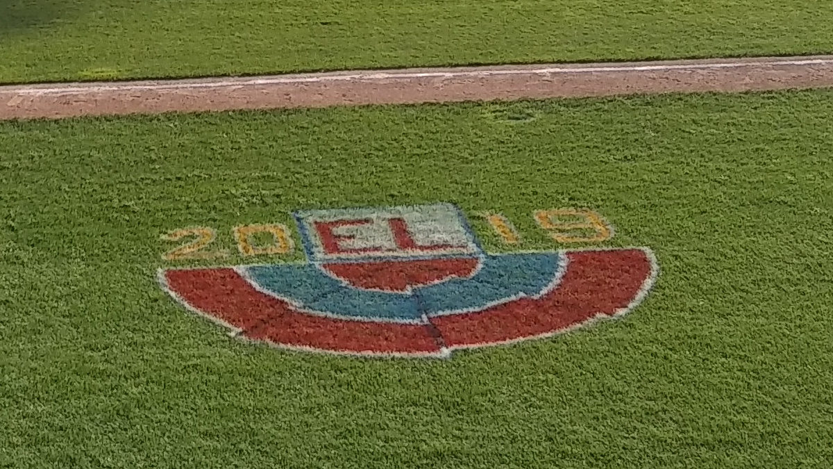 Decoration painted on the field on the third base side, which looks like patriotic bunting.