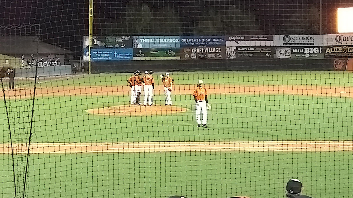 Tayler Scott walks off the field, top of the 4th
