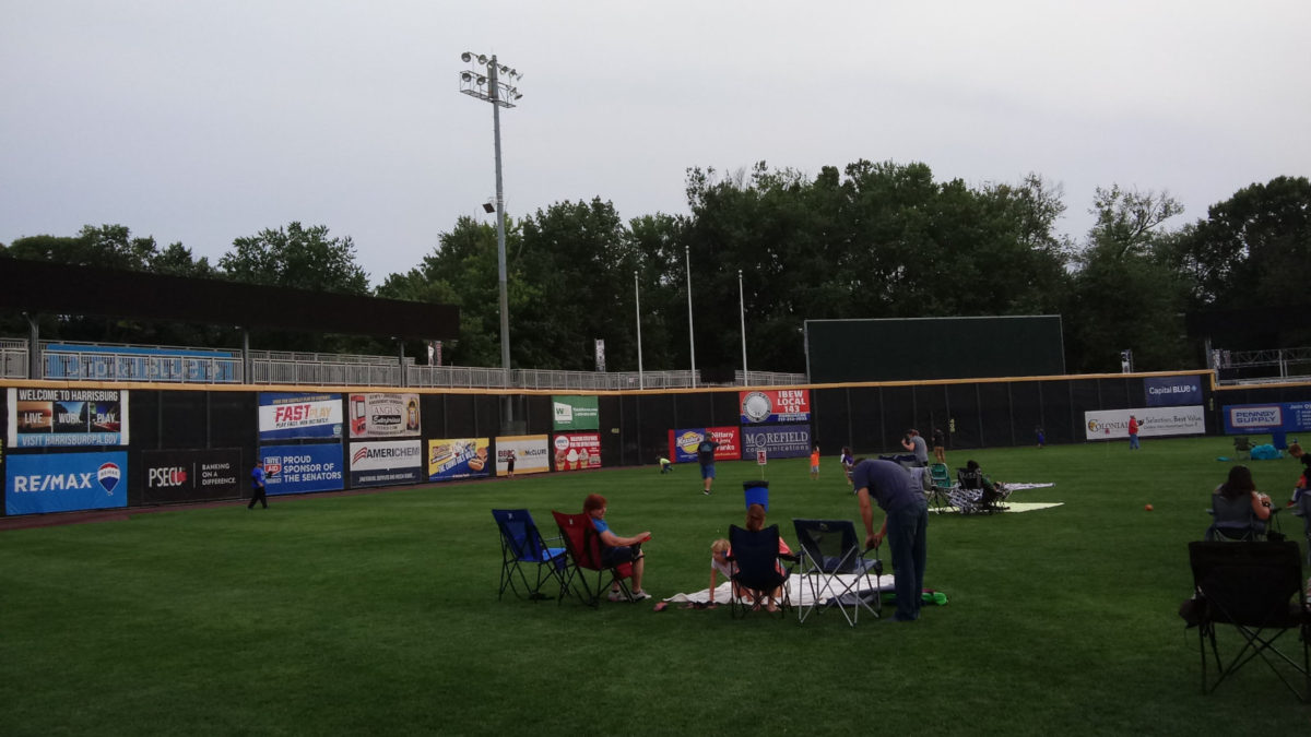 People playing catch on the outfield of FNB Field, half an hour before The Sandlot began