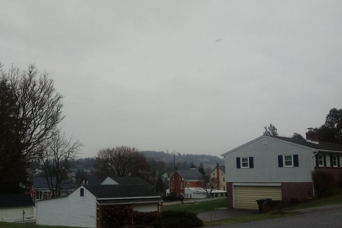 Airplane over Yoe, Pennsylvania, lost in the gray clouds