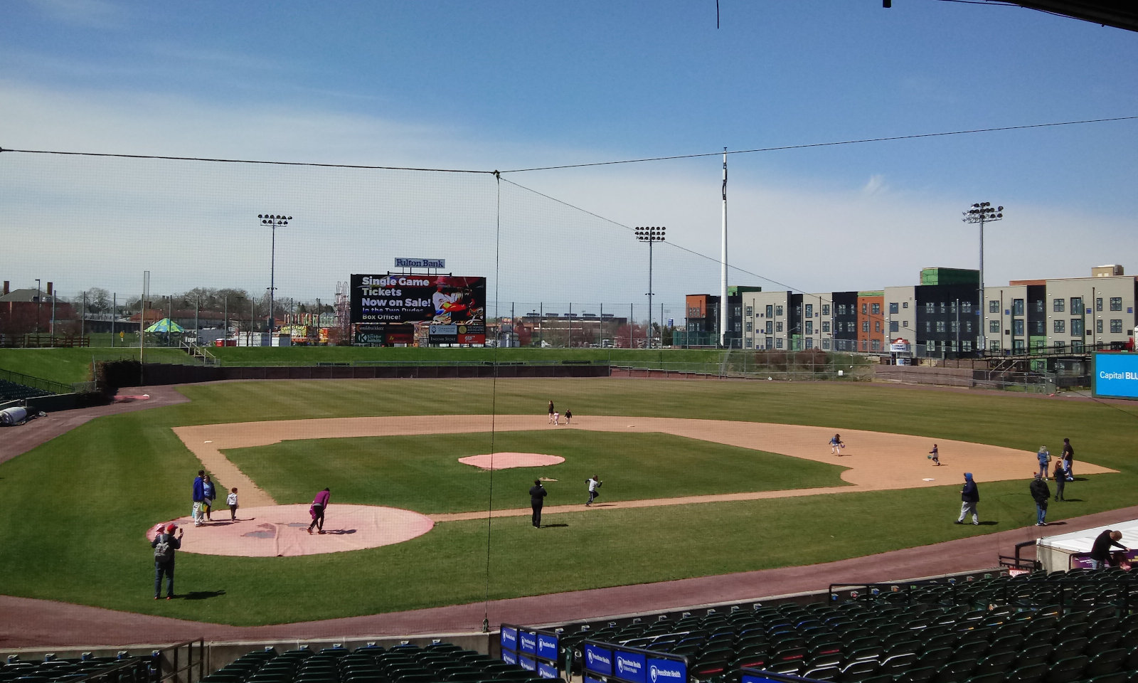 Kids hunting eggs on the infield of Lancaster's Clipper Magazine Stadium