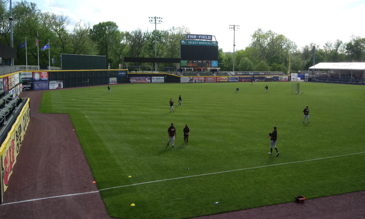 Flying Squirrels warming up on the field