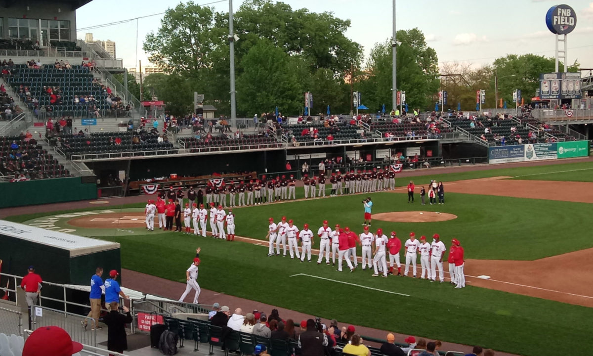 The Senators and Squirrels lined up on the baselines during the player introductions