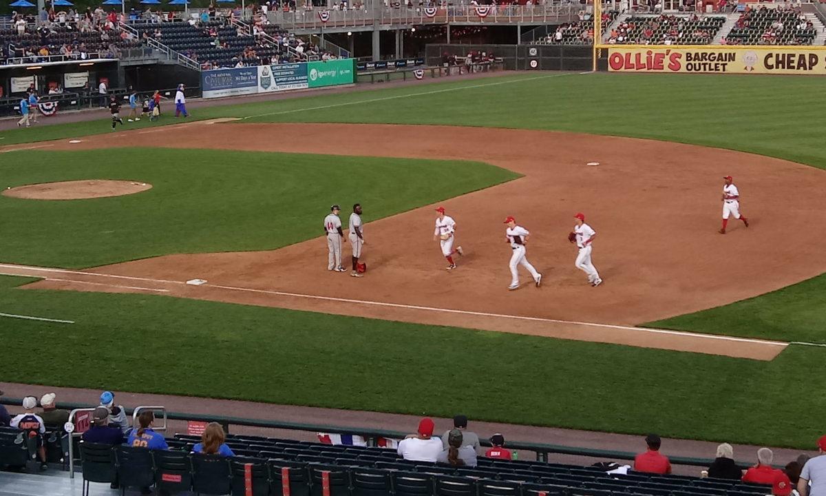 Cody Wilson passing Jacob Heyward as he runs back to the Senators' dugout