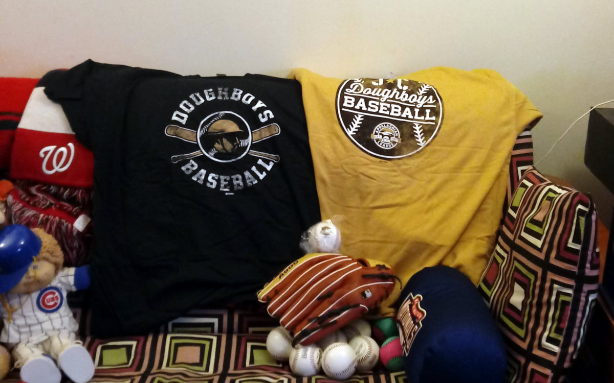 Two Doughboys t-shirts on the back of my couch