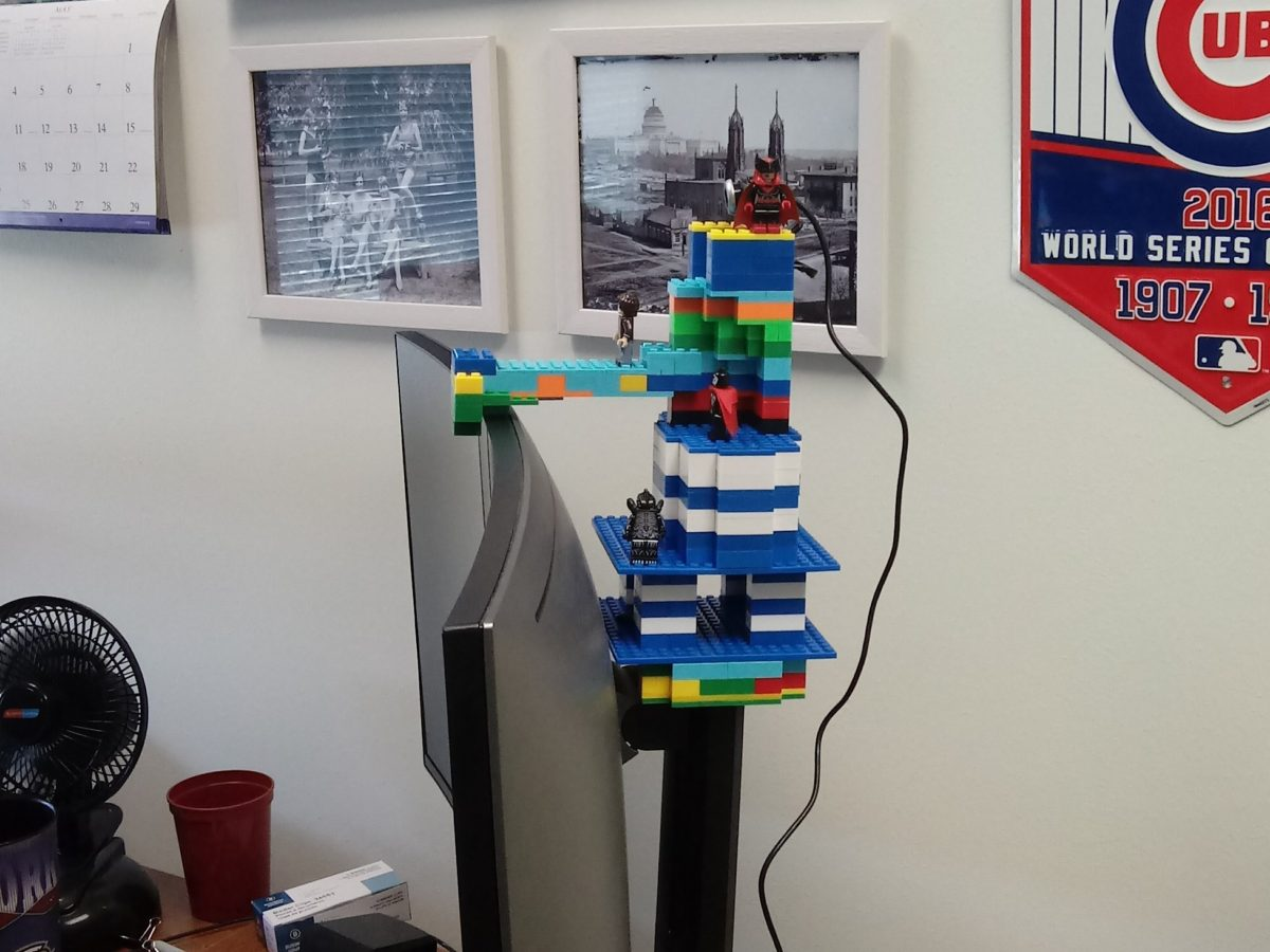 My homebrew LEGO webcam tower, adorned with several pop culture bootleg LEGO minifigs