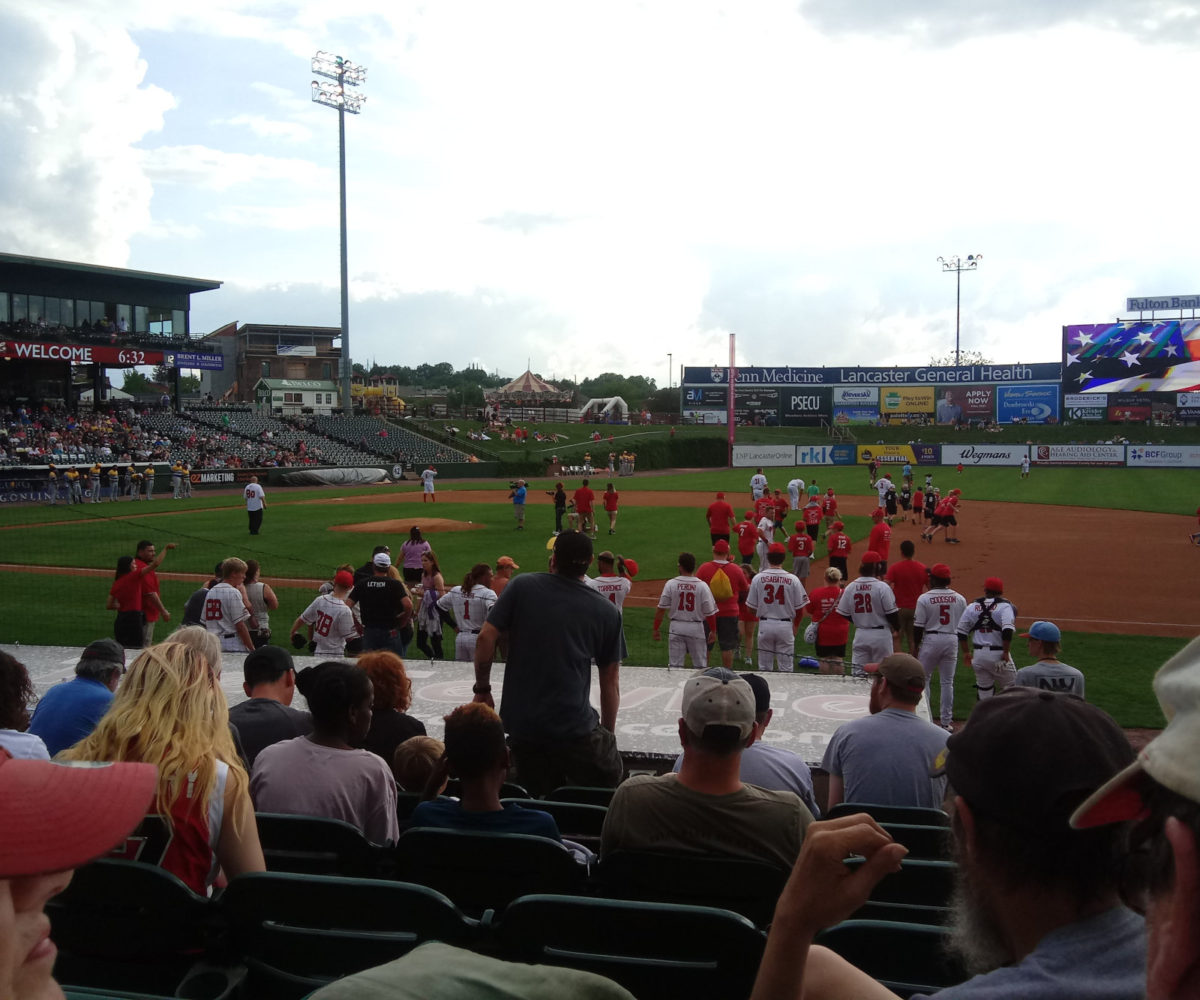 Huge masses of kids taking the field with the Barnstormers for the National Anthem