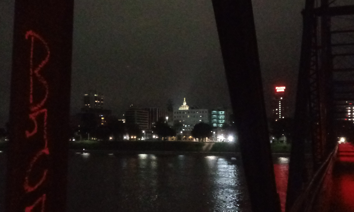 The state capitol dome, seen from the Walnut Street Bridge