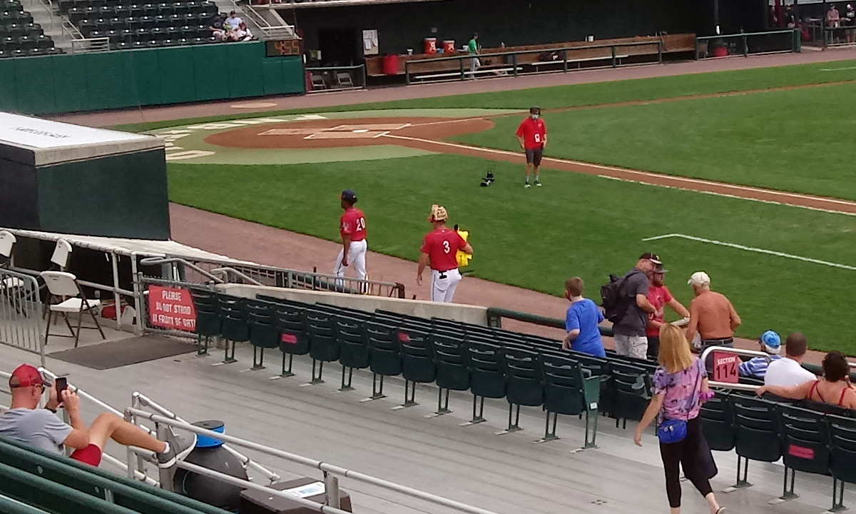 Third baseman Ian Sadgall carries the Pikachu plush with him to the dugout after signing a few autographs for fans