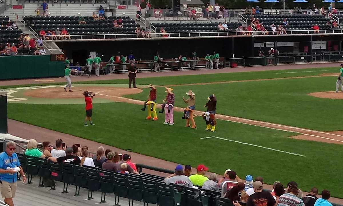Harrisburg's First and Best All-Male Dance Team -- several team executives -- entertain the crowd with a dance routine between innings