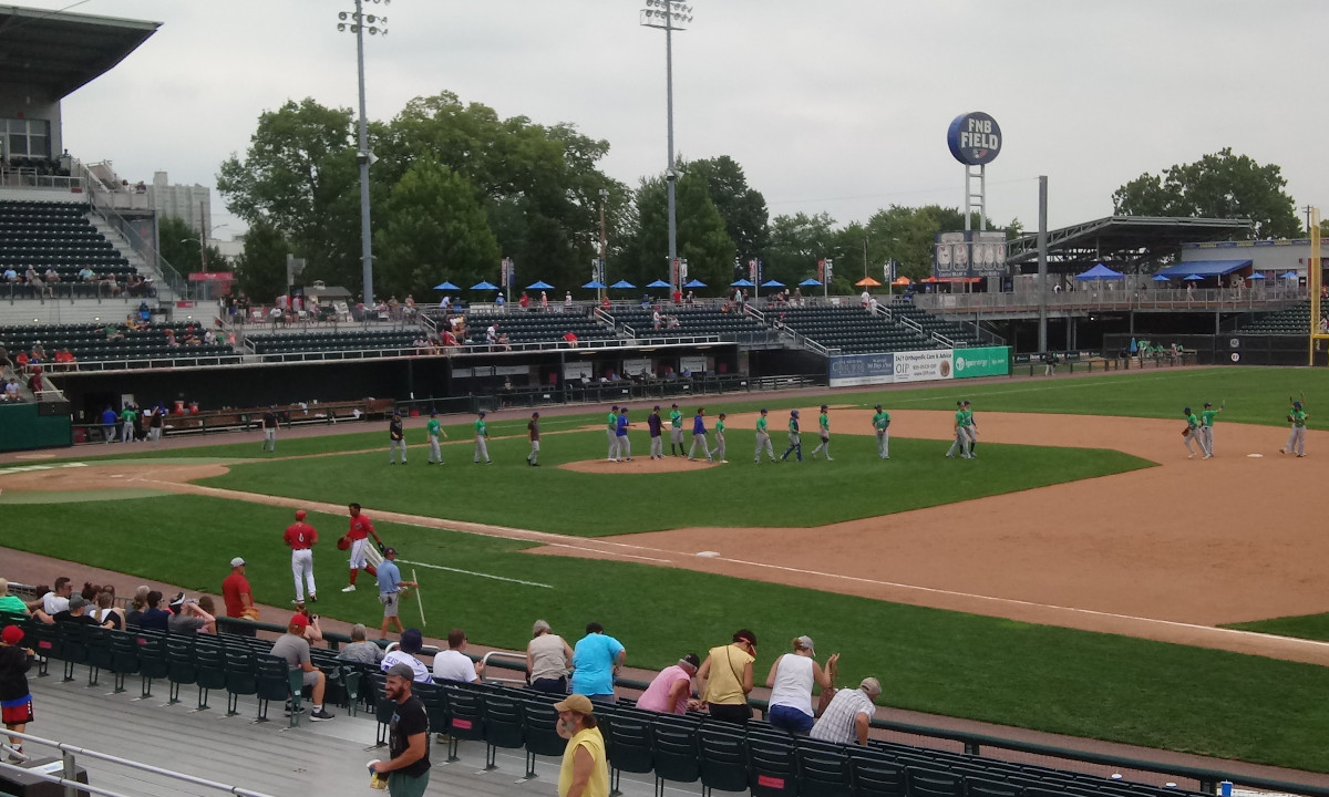 Yard Goats players line up in the infield to celebrate their victory