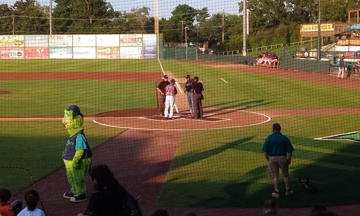 The managers exchanging line-up cards at home plate
