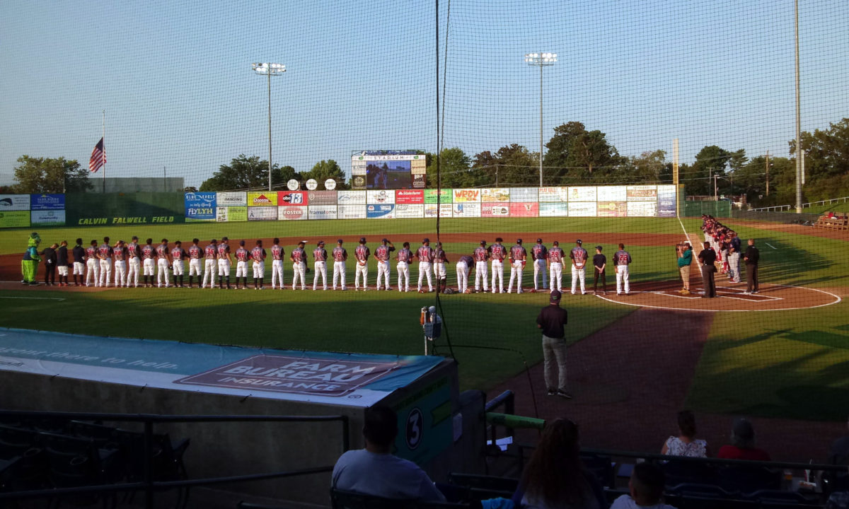 Lynchburg (on the third base line) and Salem (on the first base line), lined up for the Star-Spangled Banner, September 11, 2021