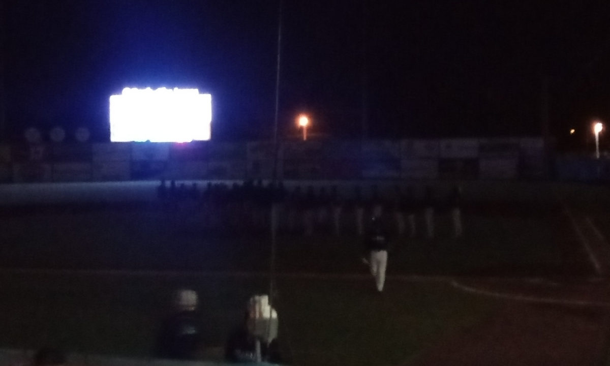 Salem celebrating their win on the infield in the dark